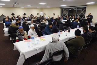 Community members and friends congratualte Helal in event at Jamia Mosque
