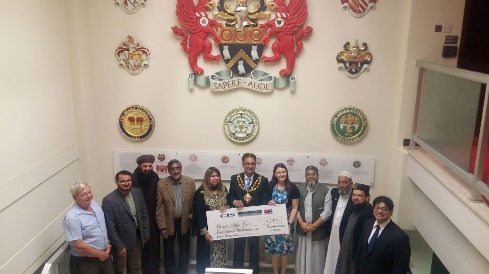 cheque for £4,259 presented to the Mayor of Oldham