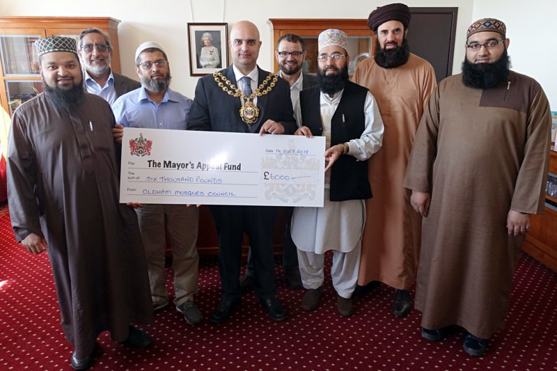 memners of Oldham Mosques' Coucil present a cheque to the Mayor - Councillor Shadab Qumer