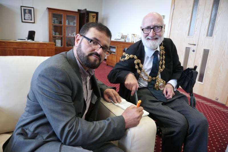Fazal Rahim signs chq from Oldham Mosques' Council to Oldham Mayor's Charities with Mayor Derek Heffernan