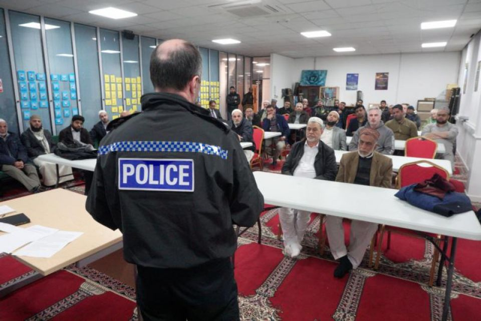 Representative from Greater Manchester Police at Oldham Mosque Coincil's meeting to show solidarity with London